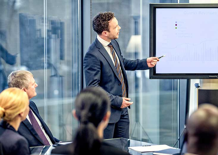 An online Master of Accountancy student uses knowledge to present findings at a board meeting.